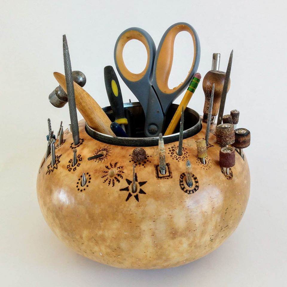 Image: A drill bit and tool holder created out of a gourd!