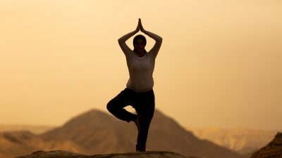 """Image: Silhouette of a person in """"tree pose"""""""