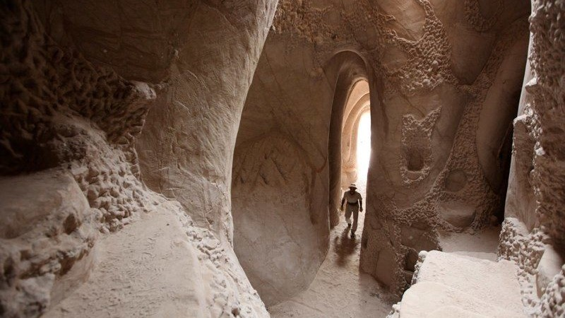 Image: Ra Paulette walking through one of his caves