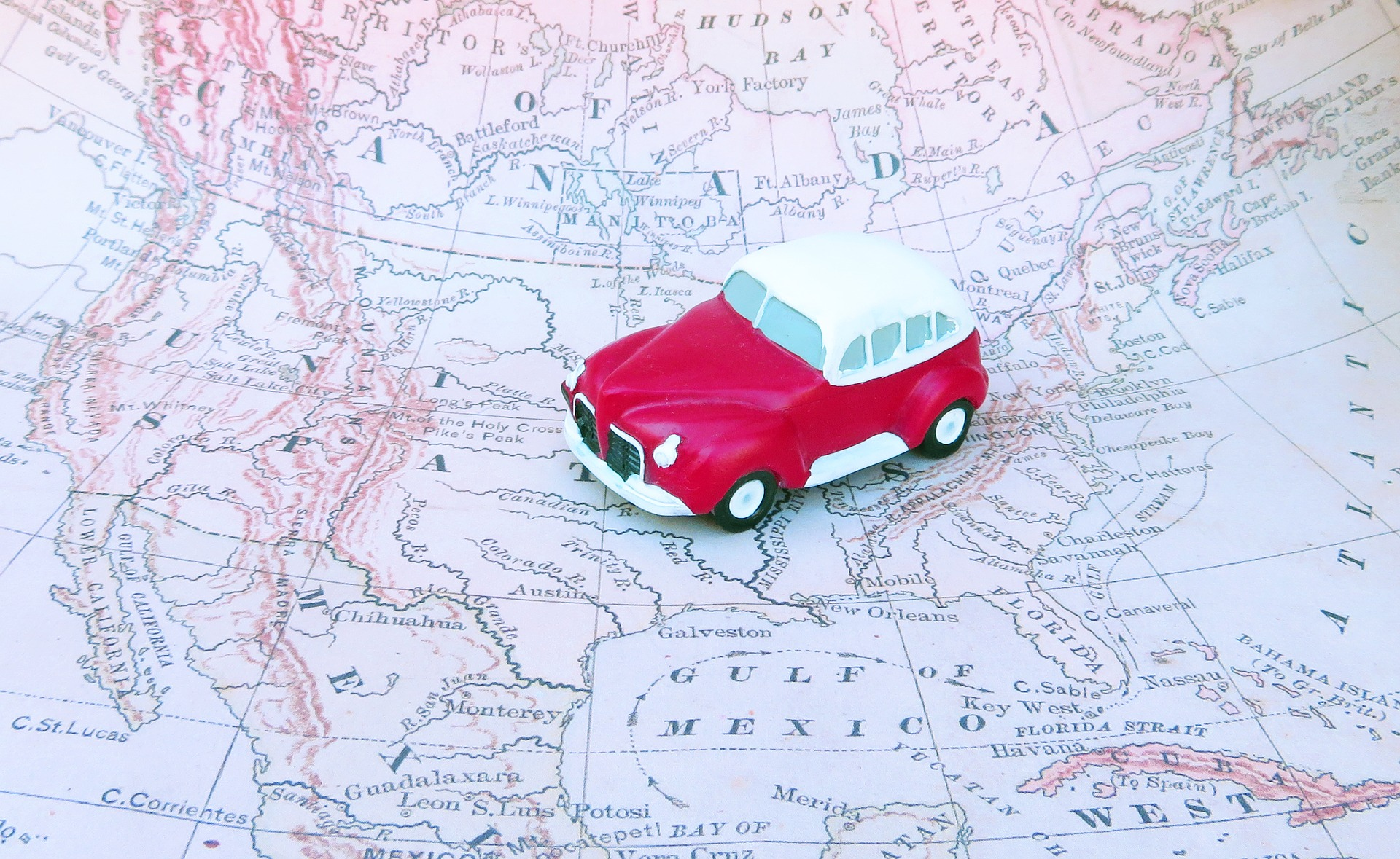 Image: toy car on top of a map of the united states