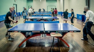 Image: seniors playing ping pong for Parkinson's