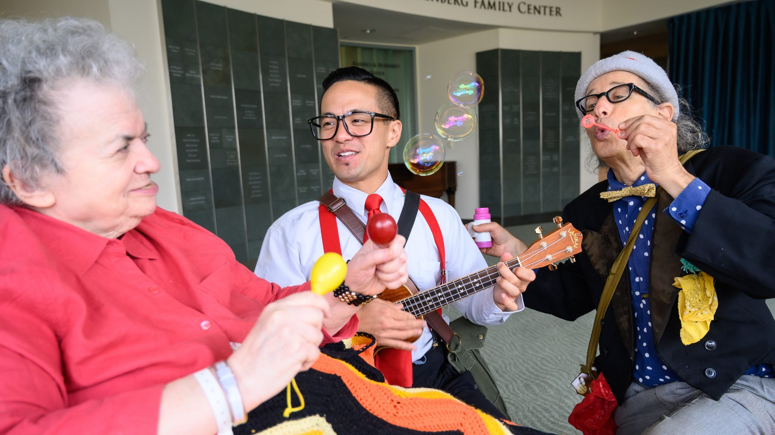 Image: Medical clowns playing music with a senior patient!