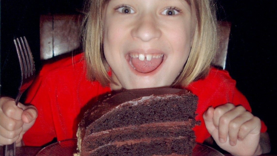 Image: young kid very excited about a giant slice ofcake!