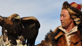 Image: Kazakh eagle hunter holding their eagle pal