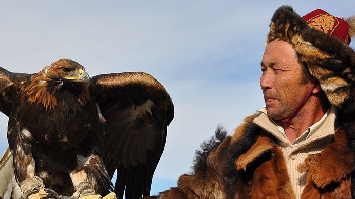 Image: Kazakh eagle hunter holding their eagle pal