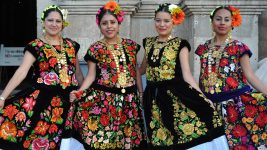 Image: women showing off their beautifully embroidered outfits