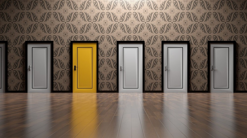 Image: 5 doors, four grey and 1 yellow