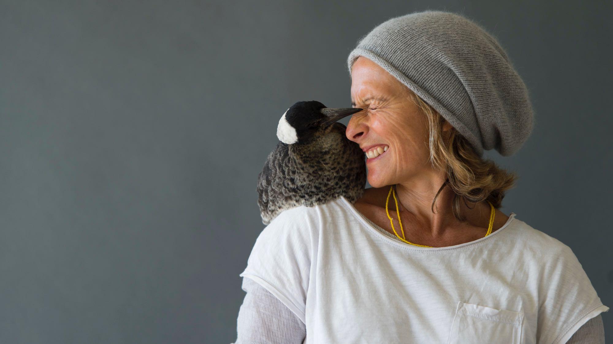 Image: Penguin Bloom sitting on Sam Bloom's Shoulder