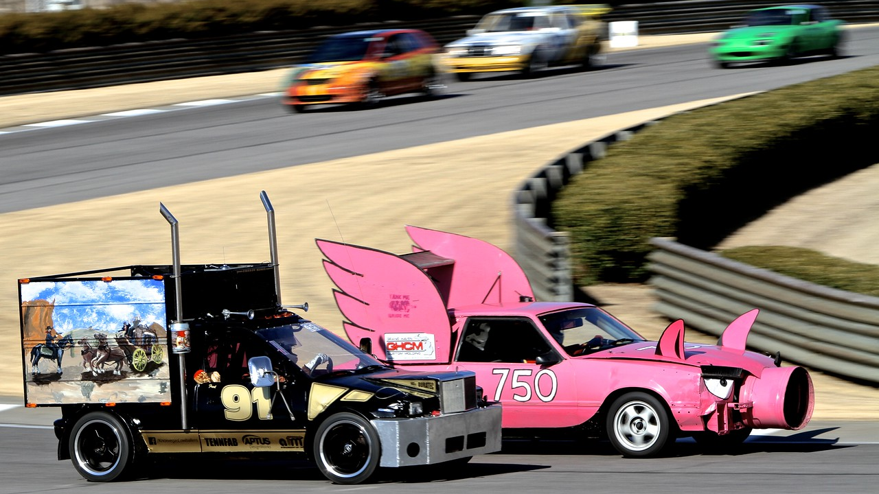 Image: two cars racing in the 24-hours of lemons