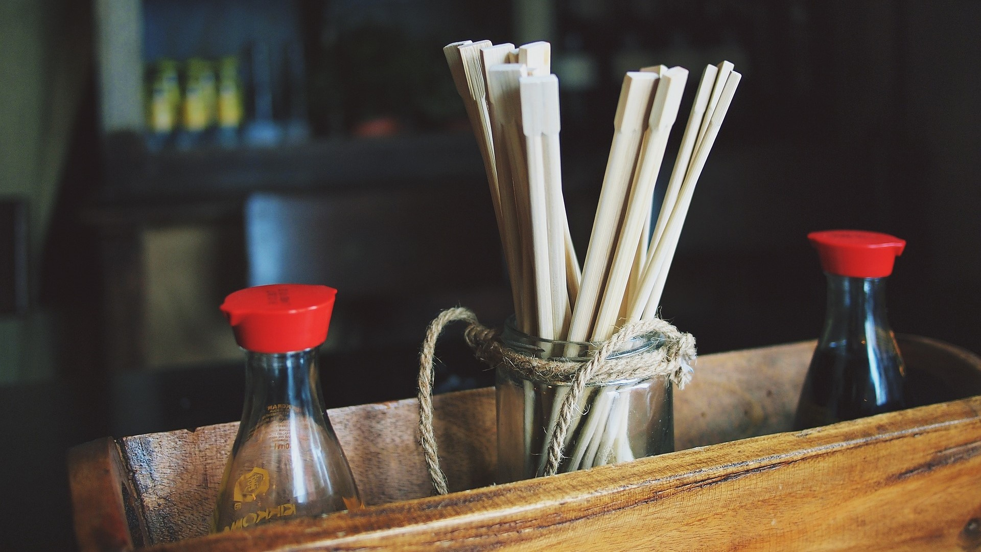 Image: Chopsticks inside of a container with soy sauce