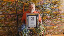 Image: Gary Duschl with his Guinness World Record award and his winning gum wrapper chain!