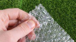 Image: Hand squeezing bubble wrap