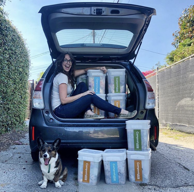 Image: person in the car with a bunch of the Compostable LA buckets!