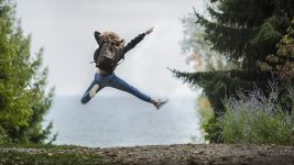 Image: Person jumping on a hiking trail