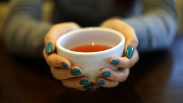 Image: Person holding a cup of tea